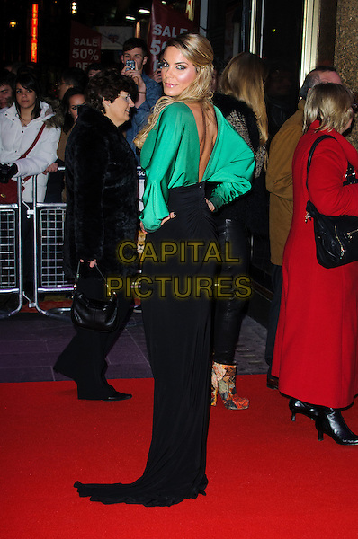 Charlotte Jackson.'Gambit' world film premiere, Empire cinema, Leicester Square, London, England..7th November 2012.full length black top skirt green blouse low cut back behind rear looking over shoulder hand on hip .CAP/CJ.©Chris Joseph/Capital Pictures.