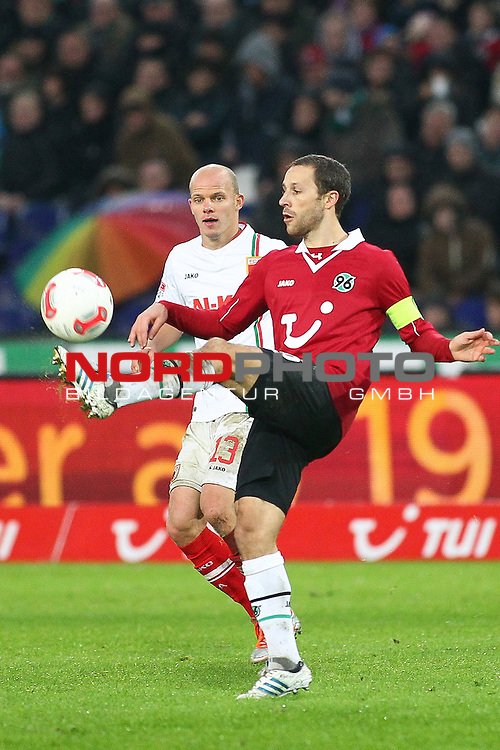 03.11.2012, AWD Arena, Hannover, GER, 1.FBL, Hannover 96 vs FC Augsburg, im Bild  Steven Cherundolo (Hannover #6) nimmt den Ball vor  Tobias Werner (FC Augsburg #13) an <br />  // during the Match GER, 1.FBL, Hannover 96 vs FC Augsburg,  AWD Arena, Hannover, Germany, on 03/11/2012,<br /> Foto &copy; nph / Schrader *** Local Caption ***