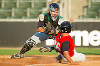 Augusta GreenJackets catcher Tommy Joseph #33 puts the tag on Rafael Vera #26 of the Kannapolis Intimidators as he tries to score a run at Fieldcrest Cannon Stadium June 24, 2010, in Kannapolis, North Carolina.  Photo by Brian Westerholt / Four Seam Images