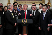 United States President Donald J. Trump, speaks behind a table full of McDonald's hamburgers, Chick fil-a sandwiches and some other fast food as he welcomes the 2018 Division I FCS National Champions: The North Dakota State Bison in the Diplomatic Room of the White House on March 4, 2019 in Washington, DC. At far right is US Senator John Hoeven (Republican of North Dakota)<br /> Credit: Oliver Contreras / Pool via CNP