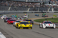 DAYTONA BEACH, FL - JAN 25: The GT field races in the first turn at the start of the Rolex 24 at Daytona at Daytona International Speedway, Daytona Beach, Florida,  January 25, 2020. (Photo by Brian Cleary/BCPix.com)