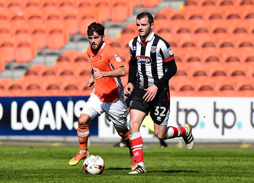 Grimsby Town's Jamey Osborne competes with Blackpool's Jack Payne<br /> <br /> Photographer Richard Martin-Roberts/CameraSport<br /> <br /> The EFL Sky Bet League Two - Blackpool v Grimsby Town - Saturday 8th April 2017 - Bloomfield Road - Blackpool<br /> <br /> World Copyright &copy; 2017 CameraSport. All rights reserved. 43 Linden Ave. Countesthorpe. Leicester. England. LE8 5PG - Tel: +44 (0) 116 277 4147 - admin@camerasport.com - www.camerasport.com