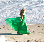 2-18-09.Wed.Beyonce Knowles filming a new music video on the beach in Malibu California..She was wearing a pretty green dress and running up and down the beach spinning around while picking the pedals off a red rose. Then Beyonce shot a scene running with another actor and she fell on accident. ....www.AbilityFilms.com.805-427-3519.AbilityFilms@yahoo.com