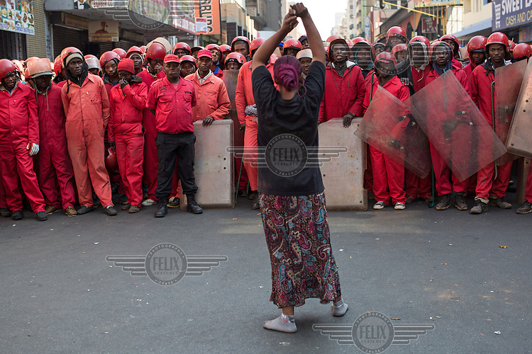 An evicted resident faces off with the Red Ants as they evict residents of a squatted building in the city centre. <br /><br />The Red Ants are a controversial private security company often hired to clear squatters from land and so-called 'hijacked' properties.