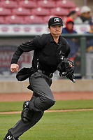 Home plate umpire Emma Charlesworth-Seiler in action during the game between the Cedar Rapids Kernels and the Burlington Bees at Veterans Memorial Stadium on April 14, 2019 in Cedar Rapids, Iowa.  The Bees won 6-2.  (Dennis Hubbard/Four Seam Images)