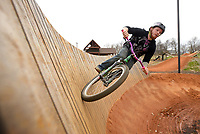 NWA Democrat-Gazette/BEN GOFF @NWABENGOFF<br /> Jonathan Sebring of Fayetteville hits a wall ride on Sunday Dec. 20, 2015 while riding the intermediate slope style line at The Railyard bike park in Rogers.
