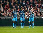 Nederland, Amsterdam, 1 december 2012.Seizoen 2012-2013.Eredivisie.Ajax-PSV .Spelers van PSV juichen nadat Jeremain Lens van PSV de 1-1 heeft gescoord. V.l.n.r.: Jetro Willems, Jeremain Lens en Dries Mertens.