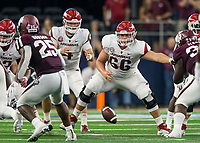 Hawgs Illustrated/Ben Goff<br /> Ty Clary, Arkansas center, snaps to quarterback Ty Storey in the 4th quarter vs Texas A&M Saturday, Sept. 29, 2018, during the Southwest Classic at AT&T Stadium in Arlington, Texas.