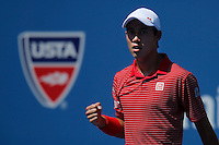 Kei Nishikori of Japan celebrates a point against Novak Djokovic of Serbia during men semifinal match at the US Open 2014 tennis tournament in the USTA Billie Jean King National Center, New York.  09.05.2014. VIEWpress
