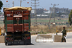 "Truckloads of humanitarian aid and commercial merchandise are seen passing through the southern Israeli ""Nahal Oz"" terminal on their way to the Gaza Strip, Monday, June 1, 2009.  Photo By: Eliyahu Ben Yigal / JINI"