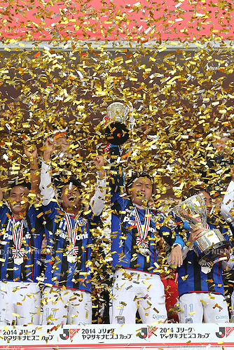 Gamba Osaka team group,<br /> NOVEMBER 8, 2014 - Football / Soccer :<br /> Confetti falls as Yasuhito Endo of Gamba Osaka celebrates on the podium with the trophy after winning the 2014 J.League Yamazaki Nabisco Cup Final match between Sanfrecce Hiroshima 2-3 Gamba Osaka at Saitama Stadium 2002 in Saitama, Japan. (Photo by Kenzaburo Matsuoka/AFLO)