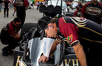 Sept. 1, 2013; Clermont, IN, USA: A crew member for NHRA top fuel dragster driver Khalid Albalooshi makes an adjustment during qualifying for the US Nationals at Lucas Oil Raceway. Mandatory Credit: Mark J. Rebilas-