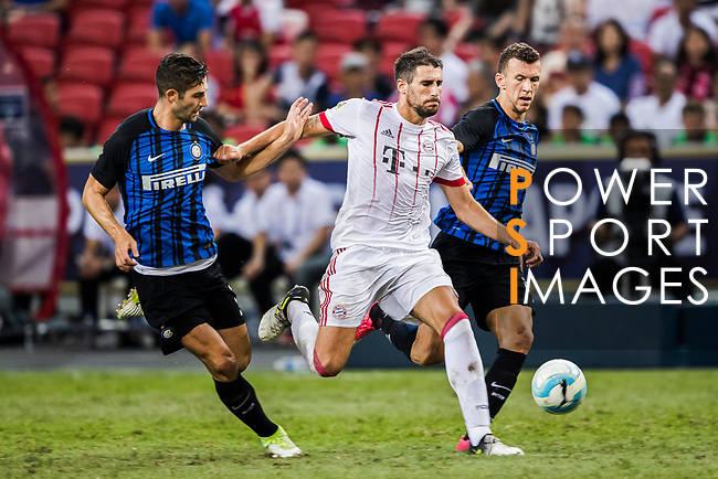 Bayern Munich Midfielder Javi Martinez (C) fights for the ball with FC Internazionale Midfielder Roberto Gagliardini (L) and FC Internazionale Forward Ivan Perisic (R) during the International Champions Cup match between FC Bayern and FC Internazionale at National Stadium on July 27, 2017 in Singapore. Photo by Marcio Rodrigo Machado / Power Sport Images