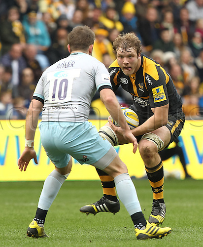 03.04.2016. Ricoh Arena, Coventry, England. Rugby Aviva Premiership. Wasps versus Northampton Saints.   Wasps lock Joe Launchbury eyes the impending tackle from Saints Stephen Myler