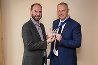 Outgoing President James Simmonds presents the Presideent's medal to Mark Deakin