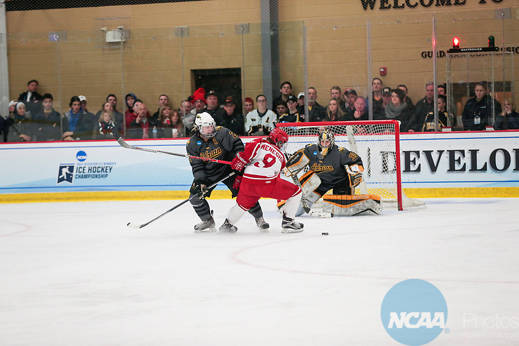 ADRIAN, MI - MARCH 18: Kayla Meneghin (9) of Plattsburgh State University loses control of the puck during the Division III Women's Ice Hockey Championship held at Arrington Ice Arena on March 19, 2017 in Adrian, Michigan. Plattsburgh State defeated Adrian 4-3 in overtime to repeat as national champions for the fourth consecutive year. by Tony Ding/NCAA Photos via Getty Images)
