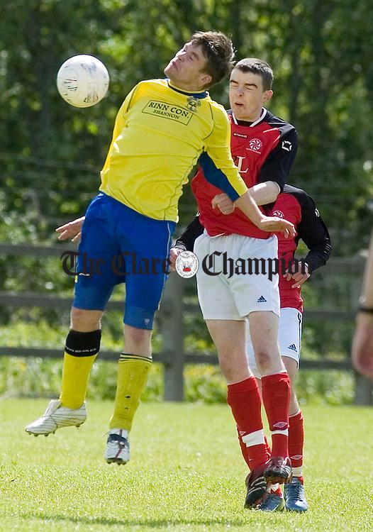 Newmarkets David O'Grady jump with Newtowns Seamus Farrell during their FAI Youth Cup match at Doora.Pic Arthur Ellis.