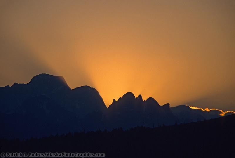 Forest fire smoke at sunset, midnight, over the Tokosha mountains, Denali National Park, Alaska.