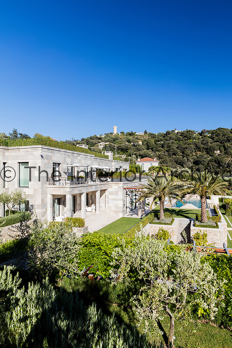 The impressive villa is a linear building designed to incorporate a series of courtyard spaces. An elevated view overlooking the landscaped gardens.