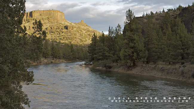 The sun sets on Chimney Rock along the Crooked River, Oregon.