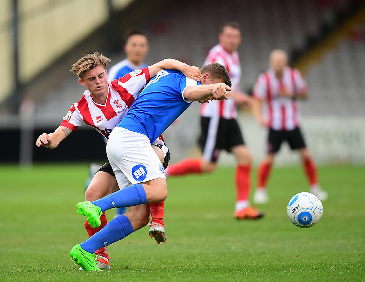 Lincoln City's Taylor Miles vies for possession with Peterborough United&rsquo;s Harry Anderson<br /> <br /> Photographer Chris Vaughan/CameraSport<br /> <br /> Football - Pre-Season Friendly - Lincoln City v Peterborough United - Tuesday 26th July 2017 - Sincil Bank - Lincoln<br /> <br /> World Copyright &copy; 2016 CameraSport. All rights reserved. 43 Linden Ave. Countesthorpe. Leicester. England. LE8 5PG - Tel: +44 (0) 116 277 4147 - admin@camerasport.com - www.camerasport.com