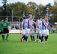 VOETBAL: LEMMER: 25-10-2015, vv Lemmer-vv Heerenveen, uitslag 0-3, felicitaties voor Stefan Bollen (#11) van Kevin Regts, (#14), ©foto Martin de Jong