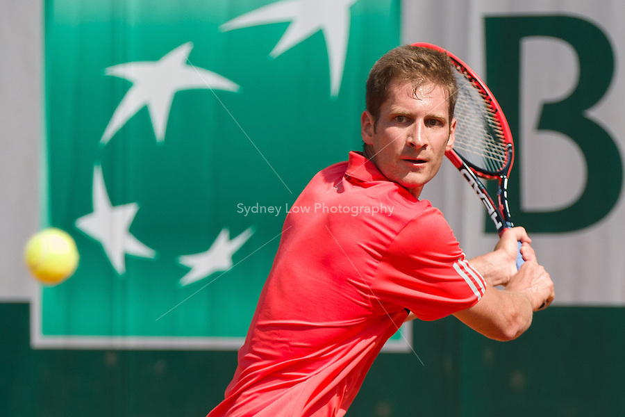 May 24, 2015: Florian Mayer of Germany in action in a 1st round match against Roberto Bautista Agut of Spain on day one of the 2015 French Open tennis tournament at Roland Garros in Paris, France. Bautista Agut won 63 61 63. Sydney Low/AsteriskImages