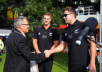 Hamilton mayor Andrew King greets NZ Sevens co-captains Tim Mikkelson (right) and Scott Curry. 2018 Hamilton Sevens Official welcome at Garden Square in Hamilton, New Zealand on Friday, 2 February 2018. Photo: Dave Lintott / lintottphoto.co.nz