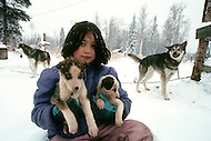 Midway Salcha Area, Alaska, U.S.A, January 1989. A sudden cold wave struck Alaska resulting to the temperature falling under 50 degrees Centigrade (58 degrees Fahrenheit). Kid and dogs.
