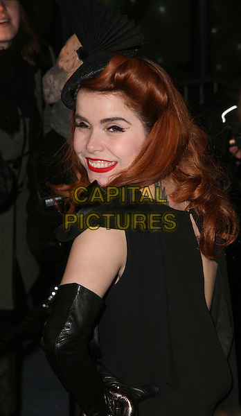 PALOMA FAITH .Arrivals at The Love Ball, the Roundhouse, Camden, London , England, UK, February 23rd 2010.half length black red lipstick make-up looking over shoulder back rear behind hat  .CAP/JIL.©Jill Mayhew/Capital Pictures.