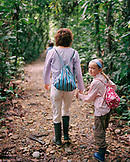 PERU, Amazon Rainforest, South America, Latin America, cute girl holding mother's hand while walking in the Amazon Rainforest.
