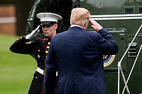 United States President Donald (R) salutes as he boards Marine One on the South Lawn of The White House on May 5, 2018 in Washington, DC. President Trump will travel to Cleveland, Ohio to speak at Public Hall ahead of state primary elections. <br /> Credit: Zach Gibson / Pool via CNP /MediaPunch