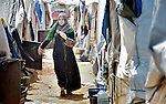 A woman walks through the El Rahmeh settlement of Syrian refugees in Bhannine, a village in the Akkar district of northern Lebanon. Lebanon hosts some 1.5 million refugees from Syria, yet allows no large camps to be established. So refugees have moved into poor neighborhoods or established small informal settlements in border areas. International Orthodox Christian Charities, a member of the ACT Alliance, provides a variety of support for families in this settlement, including water and sanitation facilities.