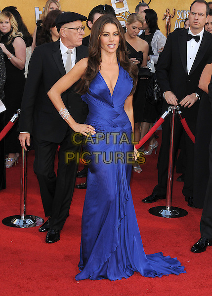 SOFIA VERGARA .at the 17th Screen Actors Guild Awards held at The Shrine Auditorium in Los Angeles, California, USA, .January 30th 2011..SAG Sags arrivals full length blue dress hand on hip long maxi cleavage low cut ruched halterneck .CAP/RKE/DVS.©DVS/RockinExposures/Capital Pictures.