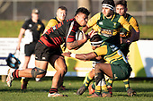 George Crichton charges towards Vilitati Sabani.Counties Manukau Premier Club Rugby game between Pukekohe and Papakura, played at Colin Lawrie Fields Pukekohe on Saturday June 9th 2018. Pukekohe won the game 37 - 22 after leading 15 - 10 at halftime. <br /> Photo by Richard Spranger.