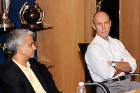 United States head coach Bob Bradley (R) answers questions as U.S. Soccer President Sunil Gulati (L) listens during a press conference announcing a contract extension for U. S. Men's National Soccer Team head coach Bob Bradley in New York, NY, on August 31, 2010.