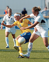 USA forward Abby Wambach, right, battles with Sweden's Sara Thunebro, left, during the first half, Saturday, July 15, 2006 in Blaine, Minn.