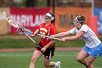 Becky Lynch (13) of North Carolina tries to take the ball away from Brittany Poist (27) of Maryland during the ACC women's lacrosse tournament finals in College Park, MD.  Maryland defeated North Carolina, 10-5.