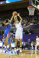 SEATTLE, WA - DECEMBER 18: Washington's #3 Mai-Loni Henson attempts a shot against Savannah State.  Washington won 87-36 over Savannah State at Alaska Airlines Arena in Seattle, WA.