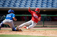 Philadelphia Phillies shortstop Luis Garcia (5) slides home as catcher Hagen Danner (26) waits to tag him during a Florida Instructional League game against the Toronto Blue Jays on September 24, 2018 at Spectrum Field in Clearwater, Florida.  (Mike Janes/Four Seam Images)