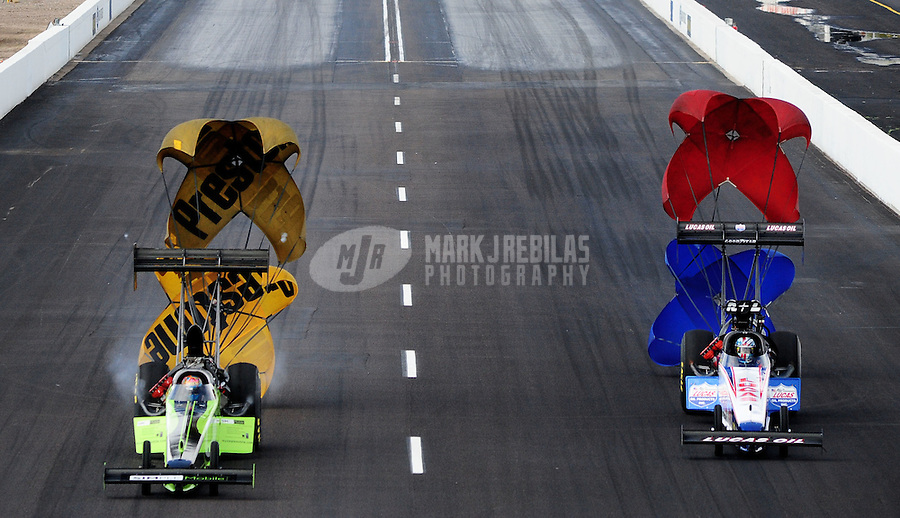 Feb. 20, 2010; Chandler, AZ, USA; NHRA top fuel dragster driver Steve Torrence (left) races alongside Shawn Langdon during qualifying for the Arizona Nationals at Firebird International Raceway. Mandatory Credit: Mark J. Rebilas-