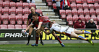 Wigan Warriors' Tom Davies scores his sides second try despite the attentions of  Huddersfield Giants' Aaron Murphy <br /> <br /> Photographer Stephen White/CameraSport<br /> <br /> Betfred Super League Round 5 - Wigan Warriors v Huddersfield Giants - Sunday 19th March 2017 - DW Stadium - Wigan<br /> <br /> World Copyright &copy; 2017 CameraSport. All rights reserved. 43 Linden Ave. Countesthorpe. Leicester. England. LE8 5PG - Tel: +44 (0) 116 277 4147 - admin@camerasport.com - www.camerasport.com