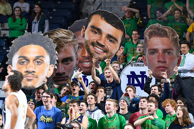 January 29, 2020; Students in the Notre Dame student section hold up oversize cutouts in an attempt to distract a free throw shooter in the second half of the game against Wake Forest at the Purcell Pavilion. (Photo by Matt Cashore)