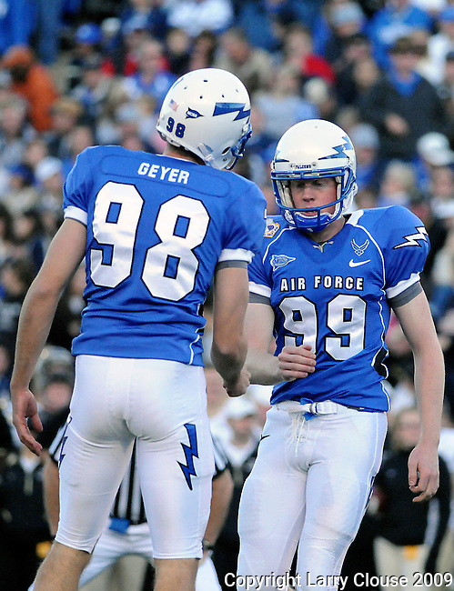 November 7, 2009:  Air Force holder, Brandon Geyer (#98), congratulates place kicker, Ryan Soderberg (#99), during the annual battle between the Army Black Knights and the Air Force Falcons at Falcon Stadium, U.S. Air Force Academy, Colorado Springs, CO.  Air Force defeats Army 35-7.