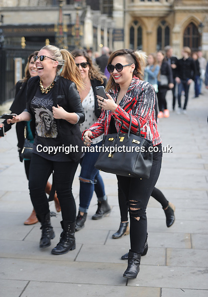 NON EXCLUSIVE PICTURE: PALACE LEE / MATRIXPICTURES.CO.UK<br /> PLEASE CREDIT ALL USES<br /> <br /> WORLD RIGHTS<br /> <br /> American actress and singer Demi Lovato is pictured out and about in London. <br /> <br /> The 21 year old looks casual wearing ripped black jeans as she takes pictures with friends and fans.<br /> <br /> MAY 29th 2014<br /> <br /> REF: LTN 142561