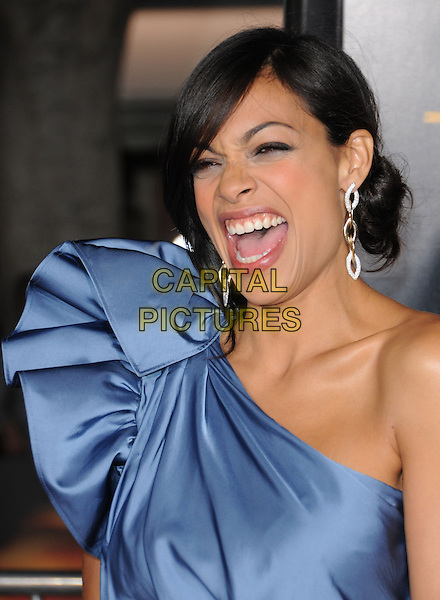 "ROSARIO DAWSON.attends the Twentieth Century Fox's L.A. Premiere of ""Unstoppable"" held at Regency Village Theater in Westwood, California, USA, October 26th 2010..portrait headshot blue one shoulder silk satin earrings dangly hair up smiling mouth open funny .CAP/RKE/DVS.©DVS/RockinExposures/Capital Pictures."