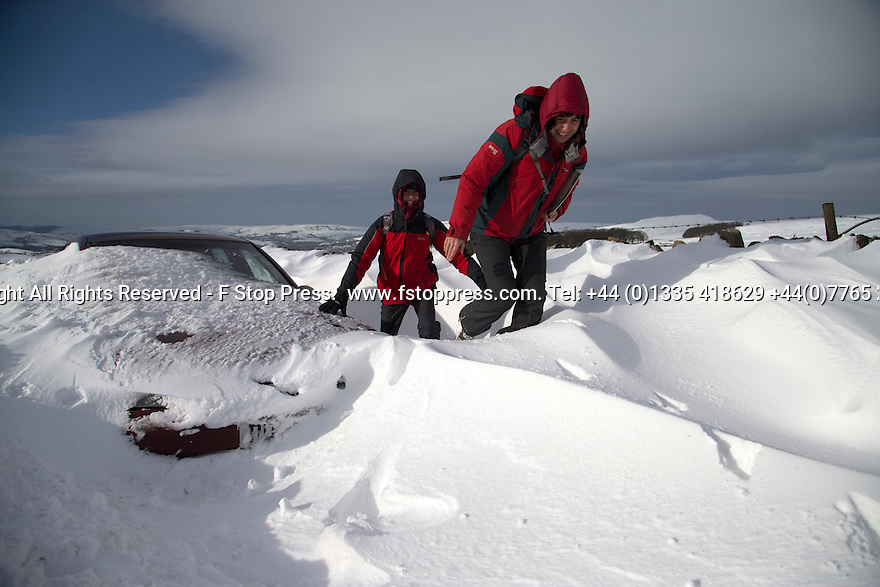 01/02/15<br /> <br /> After more overnight snow hikers trudge past a car buried in snowdrifts on Rushup Edge near Chapel-en-le-Frith in the Derbyshire Peak District.<br /> <br /> All Rights Reserved - F Stop Press.  www.fstoppress.com. Tel: +44 (0)1335 418629 +44(0)7765 242650