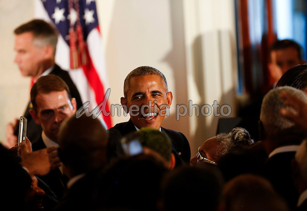 US President Barack Obama shakes hands after delivering remarks at the reception in honor of the opening of the Smithsonian National Museum of African American History and Culture, in the Grand Foyer of the White House September 22, 2016, Washington, DC. Photo Credit: Aude Guerrucci/CNP/AdMedia