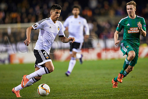 18.02.2016. Mestalla Stadium, Valencia, Spain. Europa League. Valencia versus Rapid Wien. Defender Joao Cancelo of Valencia CF (L) is  challenged  by a Rapid player