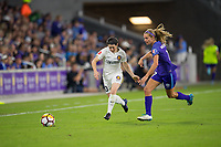 Orlando, FL - Saturday March 24, 2018: Utah Royals midfielder Diana Matheson (10) tries to dribble away from Orlando Pride midfielder Dani Weatherholt (17) during a regular season National Women's Soccer League (NWSL) match between the Orlando Pride and the Utah Royals FC at Orlando City Stadium. The game ended in a 1-1 draw.